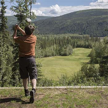 Teeing off on the Dawson City Golf Course