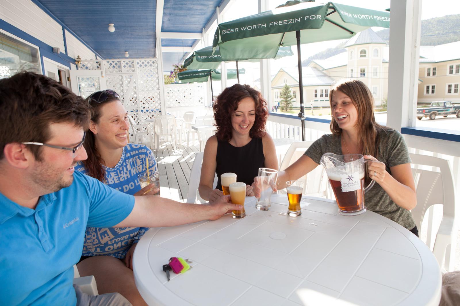 enjoying drinks on the triple j lounge patio