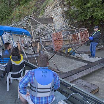 people visit a fishwheel with fishwheel charter tours