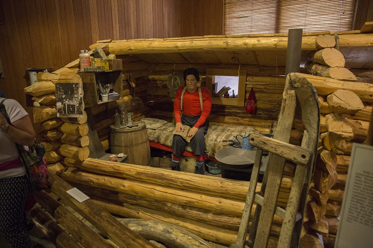 a miner's cabin exhibit at the dawson city museum