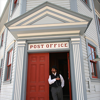 A costumed interpreter at the historic post office