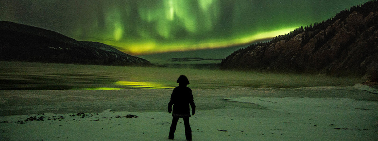 Watching the northern lights from the river