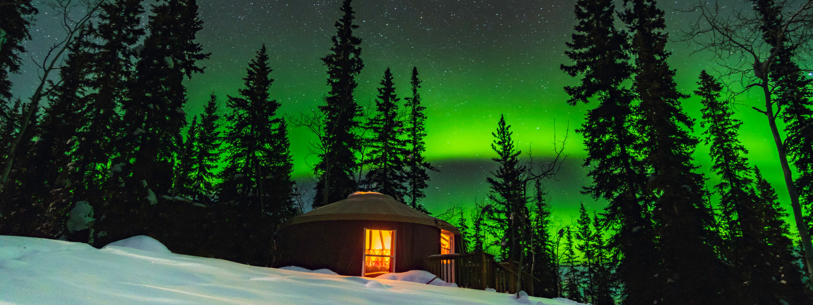 A cozy yurt under the northern lights