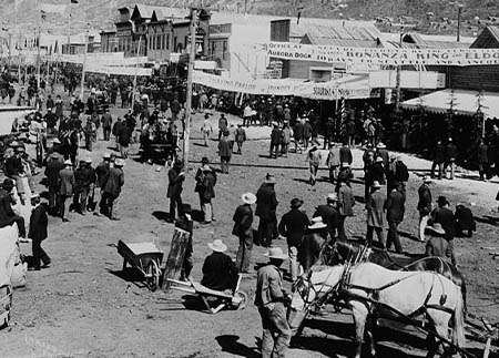 A historic black and white photo of busy Front Street during the Gold Rush