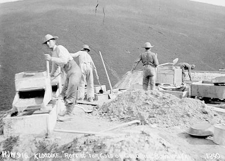 A historic black and white photo of miners on Bonanza Creek