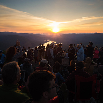 People celebrating the summer solstice on the Midnight Dome